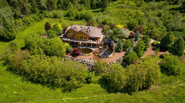 Log home luxury on 80 acres in Vernon listed by Domeij and Associates