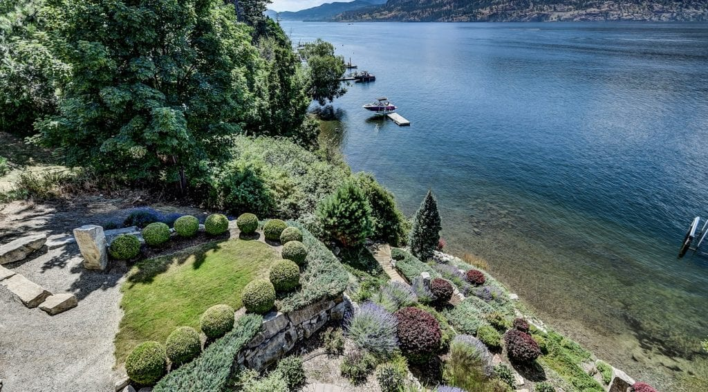 Luxury home landscape and view on lakefront property in Kelowna.